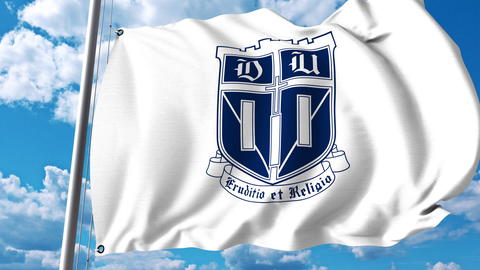 Waving flag with Duke University emblem. Editorial 3D rendering Photo
