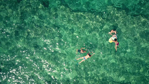 Aerial top down view of a adult couples bathing in the sea Footage