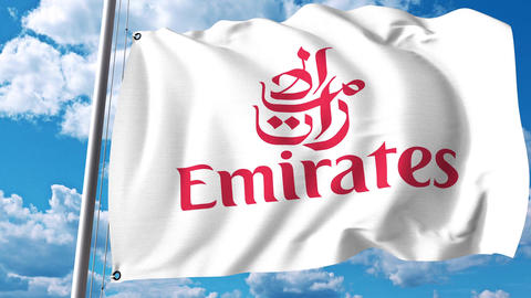 Waving flag with Emirates Airline logo. 4K editorial clip Footage