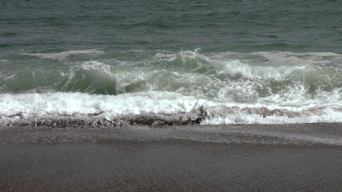 Waves that strike the coast. Slow motion video Footage