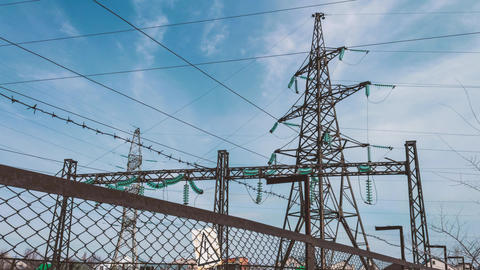 Electric substation behind the fence. Energy industry. High voltage electrical Footage