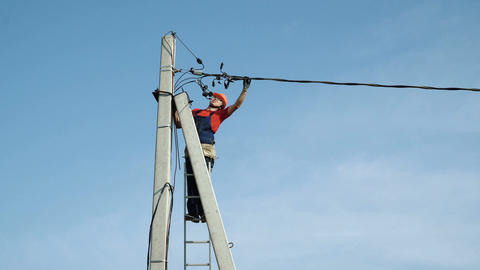 Electrician working at the power line Live Action