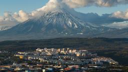 Petropavlovsk-Kamchatsky City on background Koryak Volcano Image