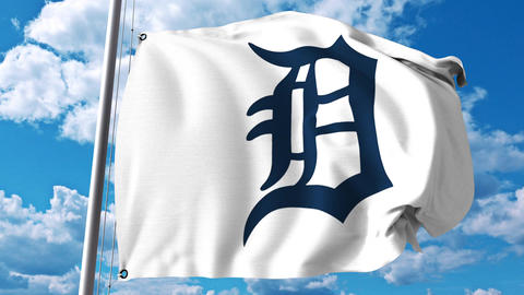 Waving flag with Detroit Tigers professional team logo. 4K editorial clip Footage