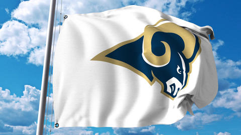 Waving flag with Los Angeles Rams professional team logo. 4K editorial clip Footage