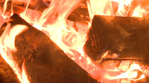 Close up Camera Shows Logs in Bright Hot Flame Spurts Footage