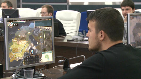 Backside View Man Looks at World Map on Monitor Footage