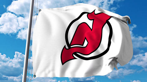 Waving flag with New Jersey Devils NHL hockey team logo. 4K editorial clip Footage