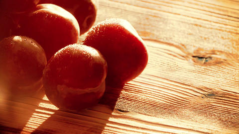 Wet ripe plums on a wooden table Footage