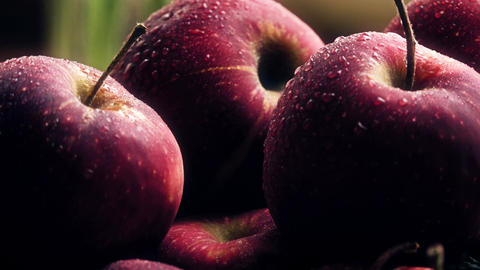 Wet ripe red apples on a wooden table Footage