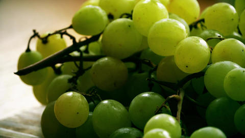 Green grapes on a wooden table Footage