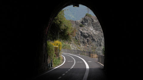 Cyclist and pedestrian tunnel view at Italian resort Footage