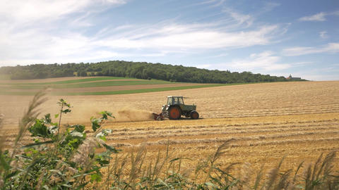 Tractor plowing wheat field after harvest Footage