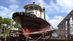 Bermuda Royal Naval Dockyard pilot boat in dry dock at the shore Archivo