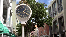 Bermuda capital old fashioned clock in front of Hamilton House in Reid Street Image
