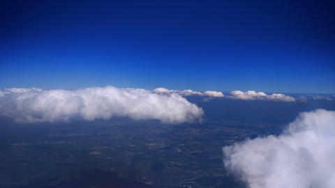 Above Puffy Clouds Archivo