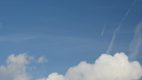 Jet airplane with trail against the blue sky Footage
