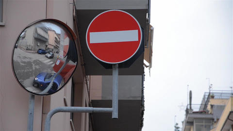 Street traffic seen by a convex mirror located at a street corner 48 Footage