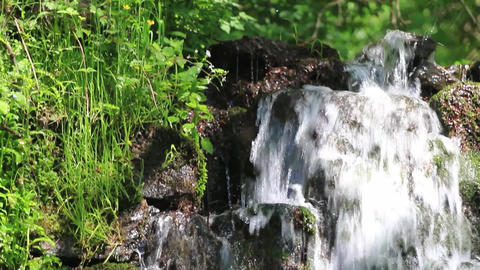Wonderful place, a waterfall in the mountains. Water flowing through rocks cover Footage