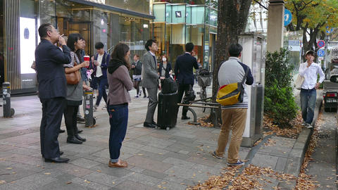 People Smoking Cigarettes In The Streets Of Tokyo Japan Asia Footage