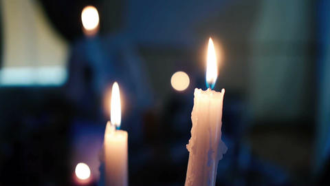 candles burning on the table ビデオ