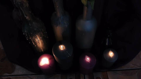 Candles are lit in a dark room Footage