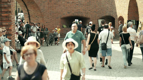 WARSAW, POLAND - JUNE 10, 2017. Tourists visit Barbican Fort in Old town Footage