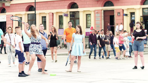 WARSAW, POLAND - JUNE 10, 2017. Girls playing promo tennis game on the street Live Action