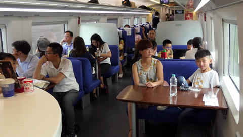 People Traveling On Dining Car On High Speed Chinese Train Live Action