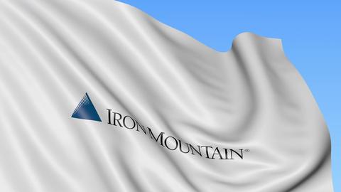 Waving flag with Iron Mountain logo. Seamles loop 4K editorial animation Footage