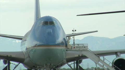 Air force one with mountains in background Live Action