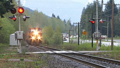 Freight train crossing side road in british columbia Footage