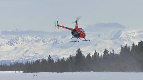 Helicopter flying to mountain range Footage
