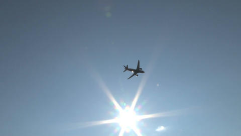 Plane taking off across sun Footage