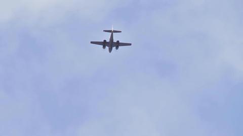 Twin engine plane flies overhead Footage