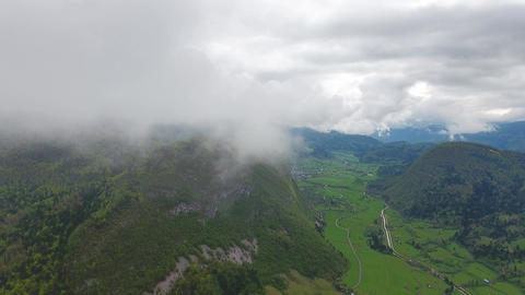 Flying through clouds over mountains in Slovenia Footage