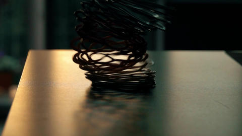 Recoiling toy spring on the table Footage