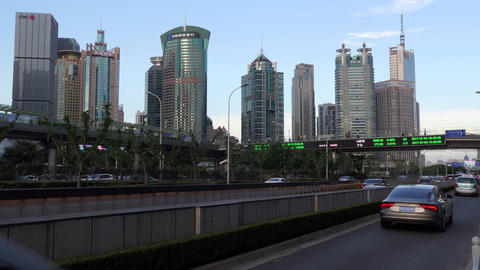 Financial District In Shanghai With Skyscrapers And Stock Exchange News Footage
