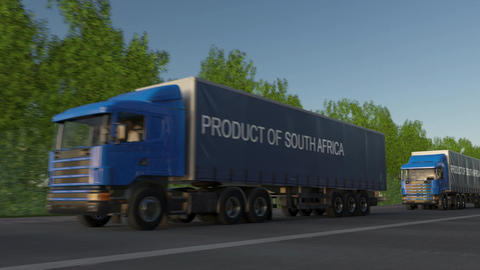 Moving freight semi trucks with PRODUCT OF SOUTH AFRICA caption on the trailer Footage
