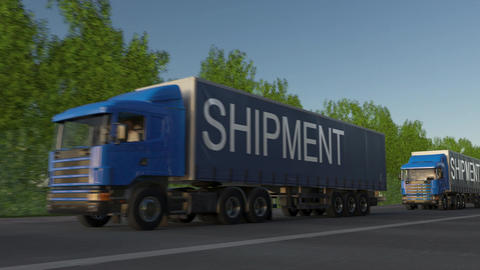 Speeding freight semi trucks with SHIPMENT caption on the trailer Footage
