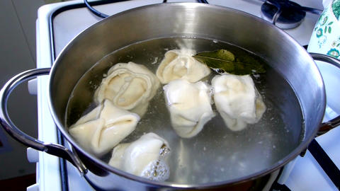 Cooking in boiling water in the kitchen Image