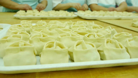 rolling dough and making dumplings Footage