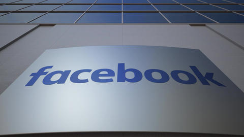 Outdoor signage board with Facebook logo. Modern office building. Editorial 3D Live Action