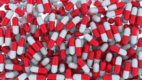 Pouring red and white drug capsules or pills Footage