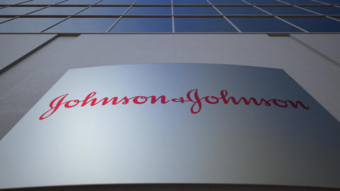 Outdoor signage board with Johnson's logo. Modern office building. Editorial 3D Footage