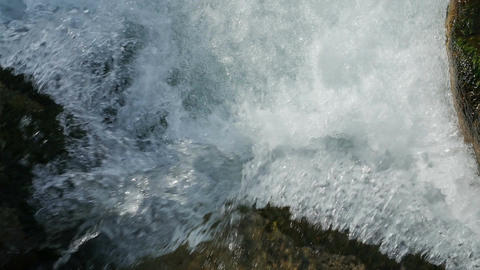 Slow motion of clean flowing water on the stones Footage