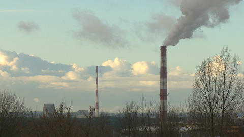 Air pollution by smoke coming out of the factory chimneys in the industrial zone Footage
