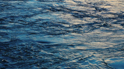 Dark blue water surface with moving ripple and air bubbles Footage