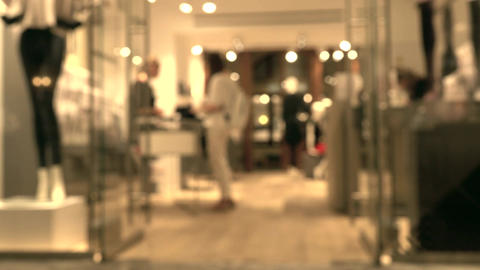 Blurred female customer and sales assistant in the store in a modern shopping Footage