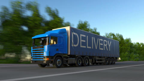 Speeding freight semi truck with DELIVERY caption on the trailer Footage
